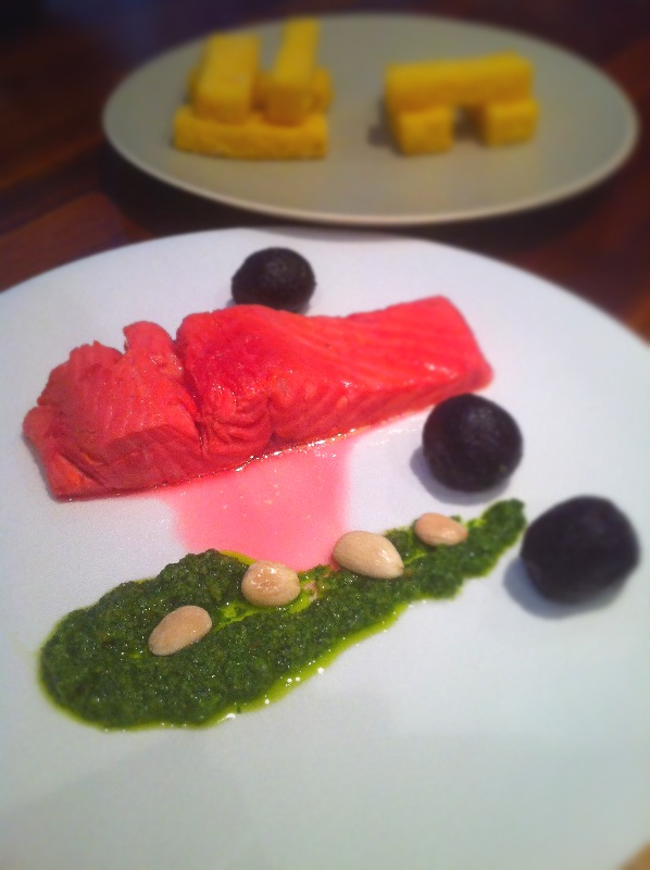 Beetroot Poached Salmon with a Marcona almond pesto.