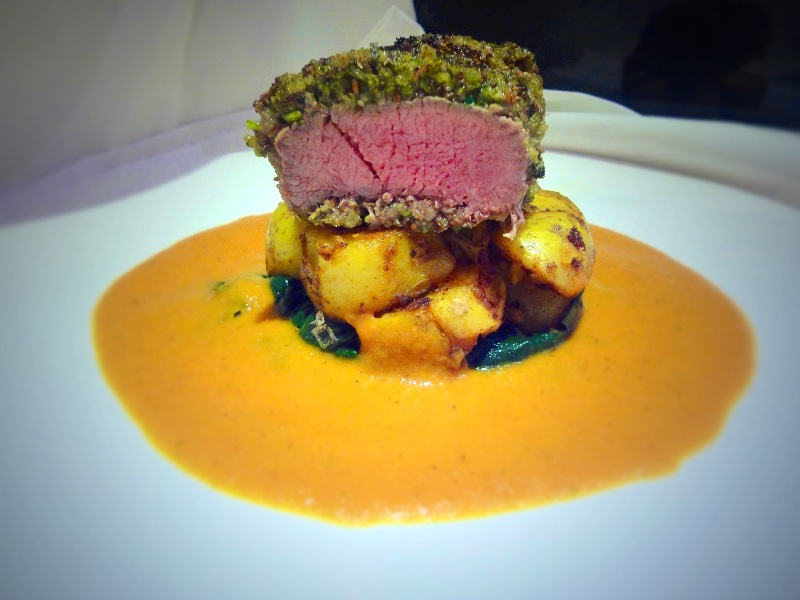 Spice Crusted Lamb Loin, Indian Potatoes and a Moilee-Tomato Sauce.
