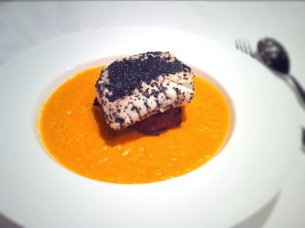 Pumpkin veloute with onion bhajis and poppy seed crusted cod.